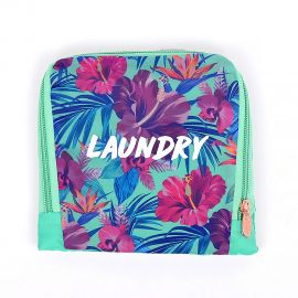 Light blue laundry bag with hibiscus floral design and white font that reads laundry. Bag appears folded into a square.