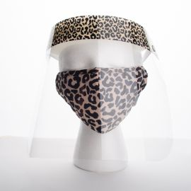 Image shows a white foam mannequin head wearing a face mask and face shield. The material of the mask and the shield's headband match, leopard print. The shield is clear plastic that extends halfway down the mannequin's neck.